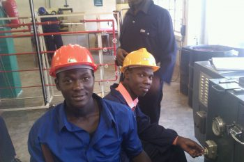 Shem (L) in hard hat